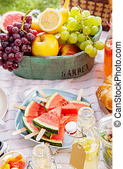 Fresh healthy tropical fruit on a picnic blanket