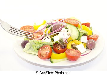Fresh healthy vegetable salad in a plate on white