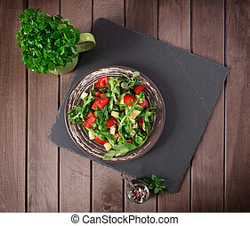vegetable salad on wooden table. top view