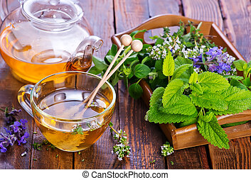 fresh herbal tea in cup and on a table