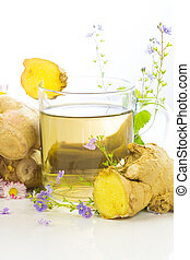 Fresh herbal tea or infusin with root ginger and herbs, used to aid weight loss and detoxifying
