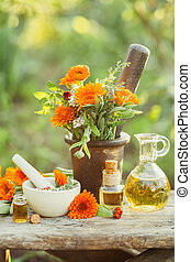 Fresh herbs, calendula and different types of oils.
