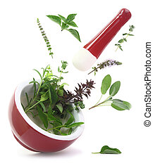 Fresh herbs falling into a porcelain mortar