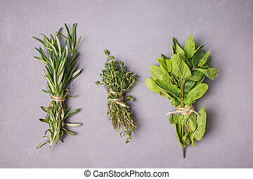 Fresh herbs on stone background, top view