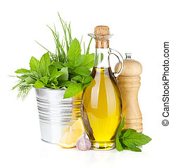 Fresh herbs, spices, olive oil and pepper shaker. Isolated ...