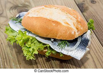Fresh Herring on a roll (wooden background) - Fresh Herring...
