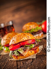 Fresh home-made hamburgers served on wooded table with pomme...