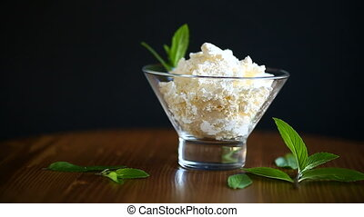 fresh homemade cottage cheese in a glass bowl
