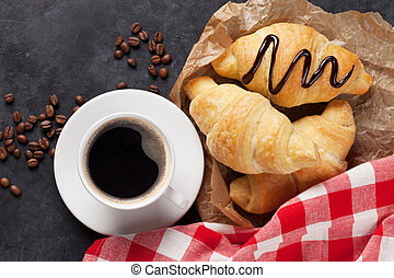 Fresh homemade croissant with chocolate and coffee