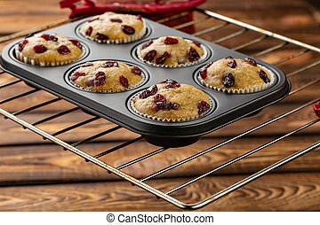 homemade muffins with dried cherry in bakeware - Fresh...