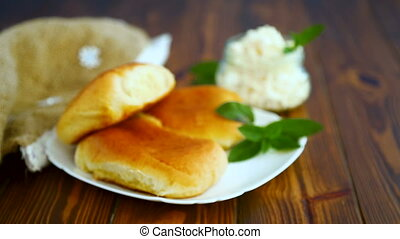 fresh homemade sweet pies with cottage cheese on a wooden...