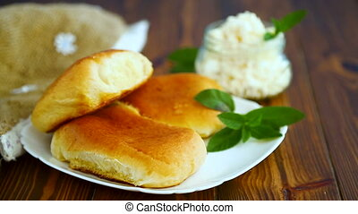 fresh homemade sweet pies with cottage cheese on a wooden table