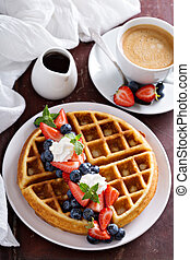 Fresh homemade waffles with ricotta served with whipped...