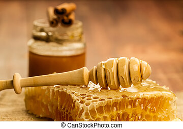 fresh honey and drizzler on a wooden background. Autumn...