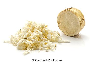 Fresh horseradish isolated on white - Freshly grated mash of...