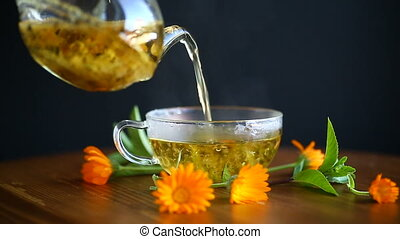 fresh hot tea with calendula