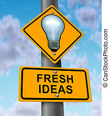 Fresh ideas and new innovative solutions symbol with a road and traffic sign with a light bulb on yellow street signage as an icon of successful direction in developing innovation and inventing original content.