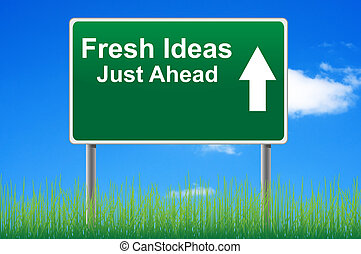Fresh ideas road sign on sky background, grass underneath.