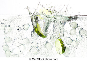 fresh image of a beverage gin tonic with cucumber and ice cubes