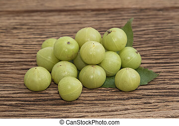 Fresh Indian gooseberry on wooden background