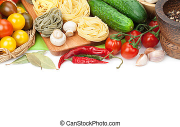 Fresh ingredients for cooking: pasta, tomato, cucumber, mushroom and spices. Isolated on white background
