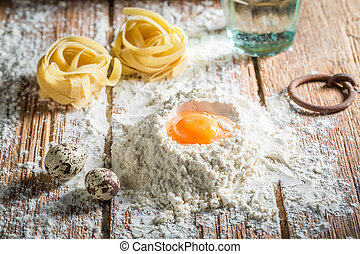 Fresh ingredients for pasta with flour and eggs