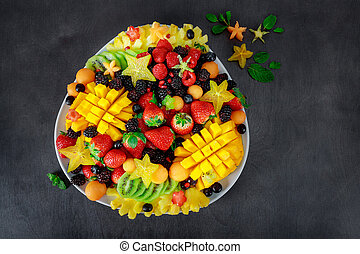 Fresh ingredients on wooden background, top view. Health or detox diet food concept.