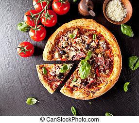 Fresh italian pizza served on black stone