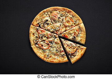 Fresh italian pizza with mushrooms, tomatoes, cheese, on black stone background