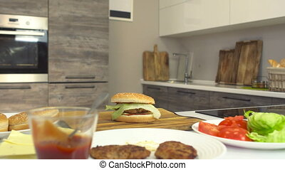 Fresh juicy cooked cheeseburger in a modern kitchen and...