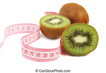 Fresh juicy kiwi fruit with tapemeasure