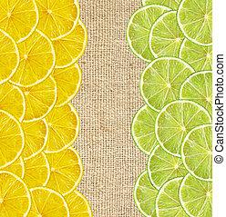fresh juicy lemon and lime slices on canvas burlap background