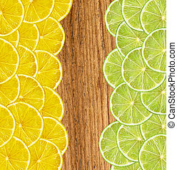 fresh juicy lemon and lime slices on wooden background