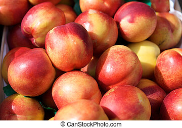 Fresh juicy nectarines in the box