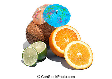 Fresh juicy orange, coconut and green lime with a cocktail umbrella isolated on white background. Concept of Healthy eating and dieting. Travel and holiday concept