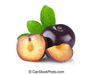 Fresh juicy organic plum with green leaf