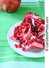fresh juicy pomegranate on a plate