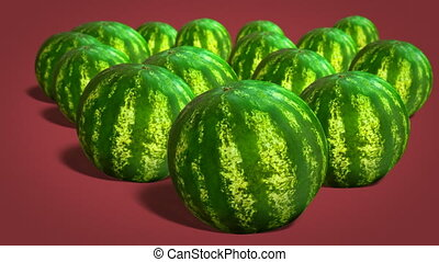 Fresh juicy watermelons - Ripe whole watermelons on red...