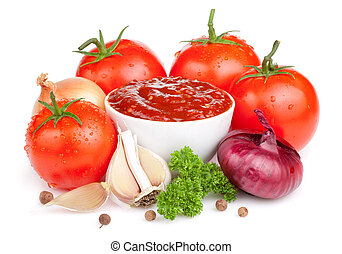 Fresh ketchup and a set of vegetables: tomatoes, onions, garlic and parsley isolated on white background