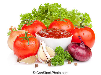 Fresh ketchup and a set of vegetables: tomatoes, onions, garlic, parsley and lettuce isolated on white background