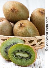 Fresh kiwi fruit whole and cut. Selective focus