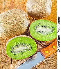 fresh kiwi on the wooden board