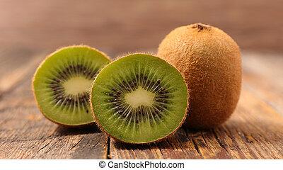 fresh kiwi on wood background