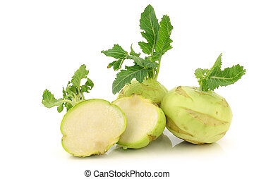 fresh kohlrabi cabbages and a cut one on a white background