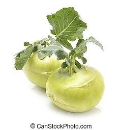 Fresh kohlrabi with green leaves