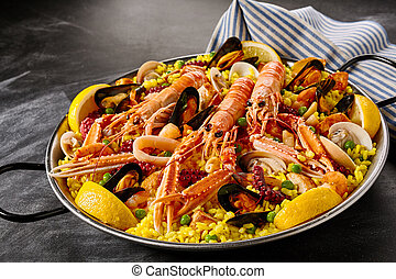Fresh langoustines in a seafood paella