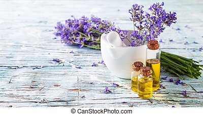Fresh lavender on wood - Lavender bunch with oil and soap on...