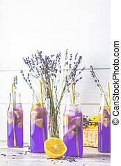 Fresh lavender violet cocktail with lemon and ice