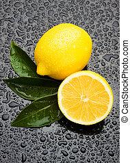 Fresh lemon fruit on wet surface