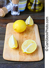 Fresh lemon on a cutting board